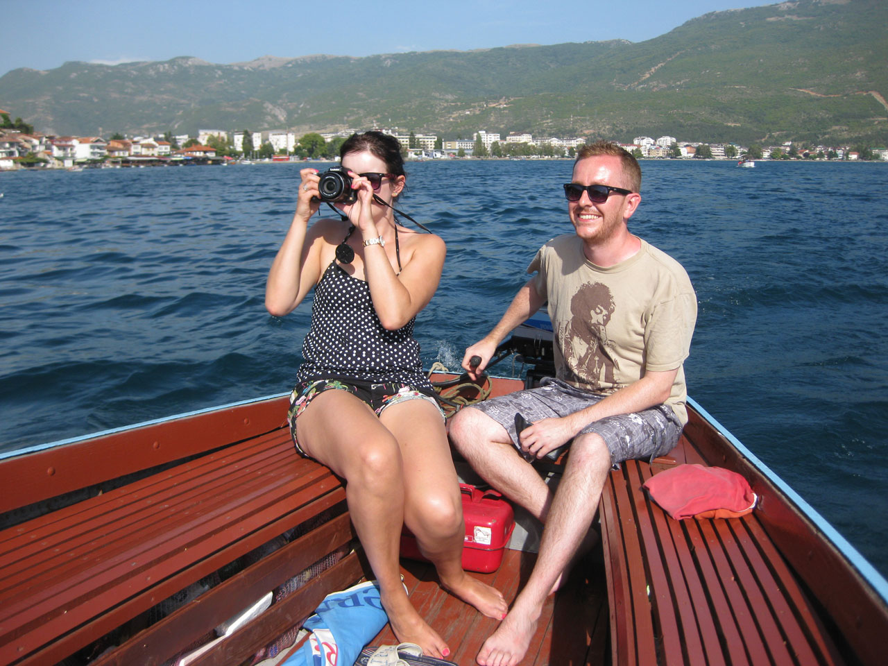 Me steering the boat around Lake Ohrid, Macedonia