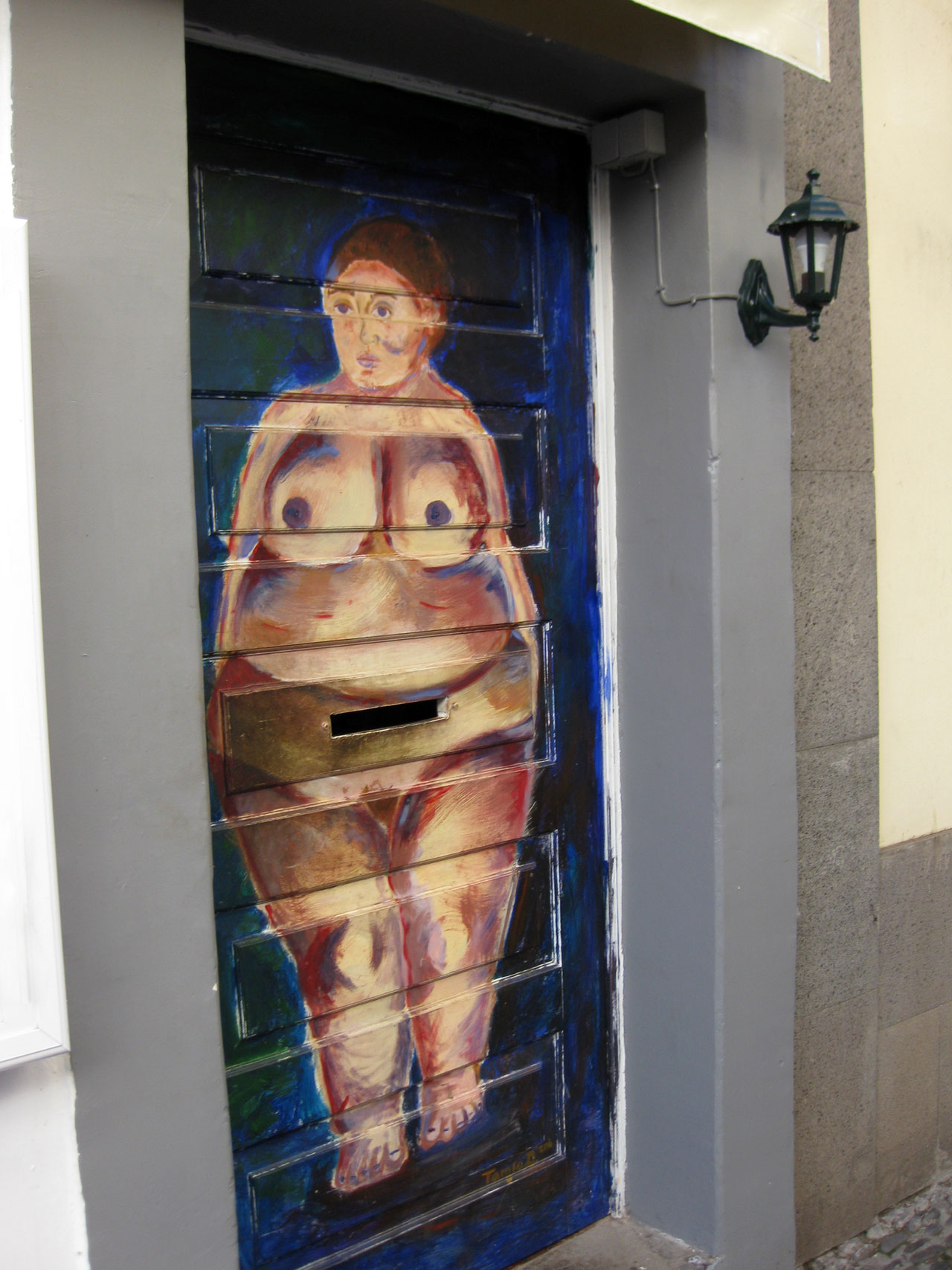 Nude woman painted on a door in Funchal