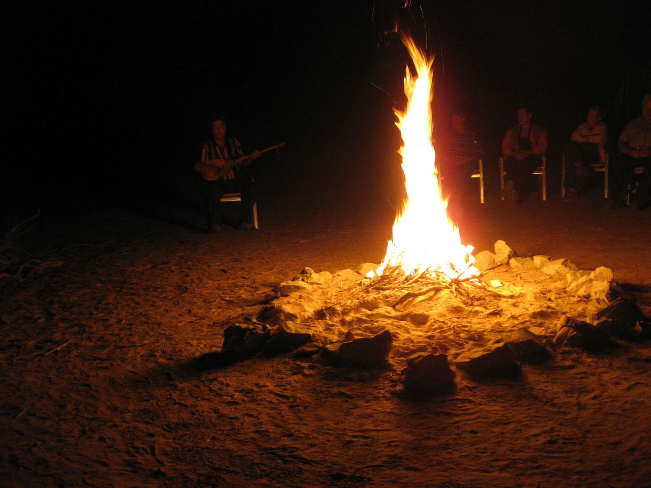 Traditional Kazakh songs around the campfire at Yangikazgan, Uzbekistan