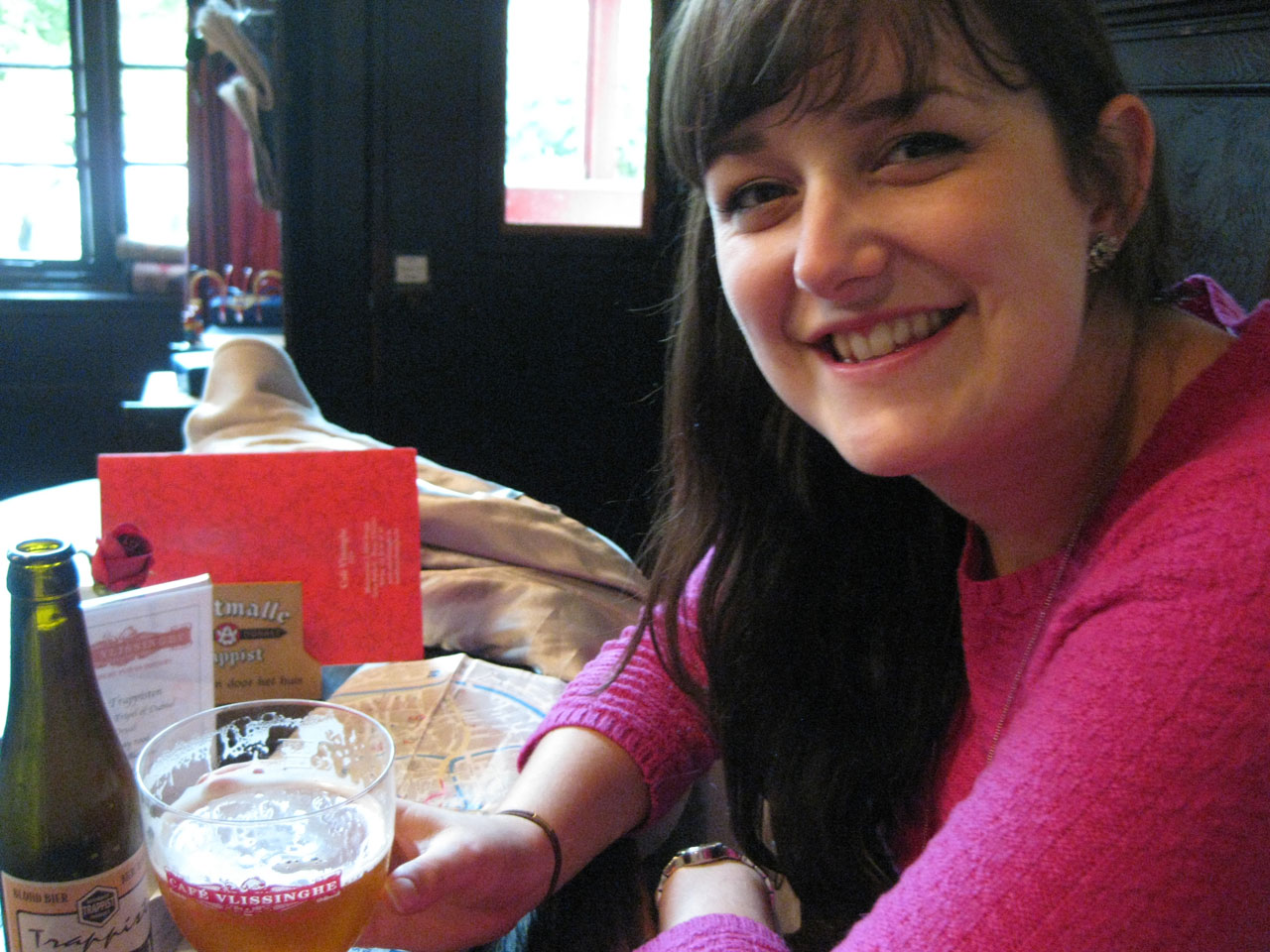 Polly sampling a Trappist beer at Café Vlissingghe, Bruges, Belgium