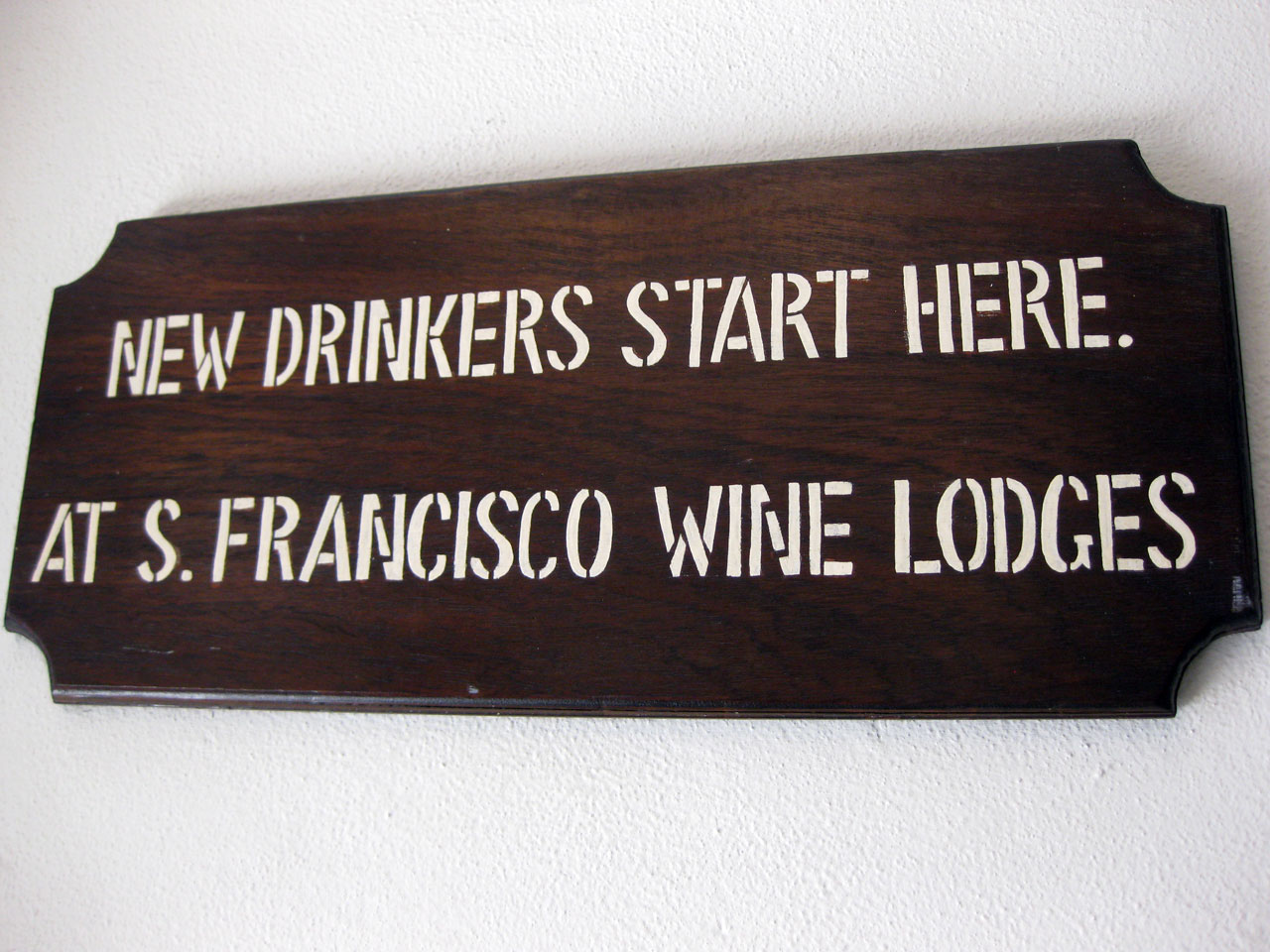 Sign reads 'New drinkers start here, at San Francisco Wine Lodges'