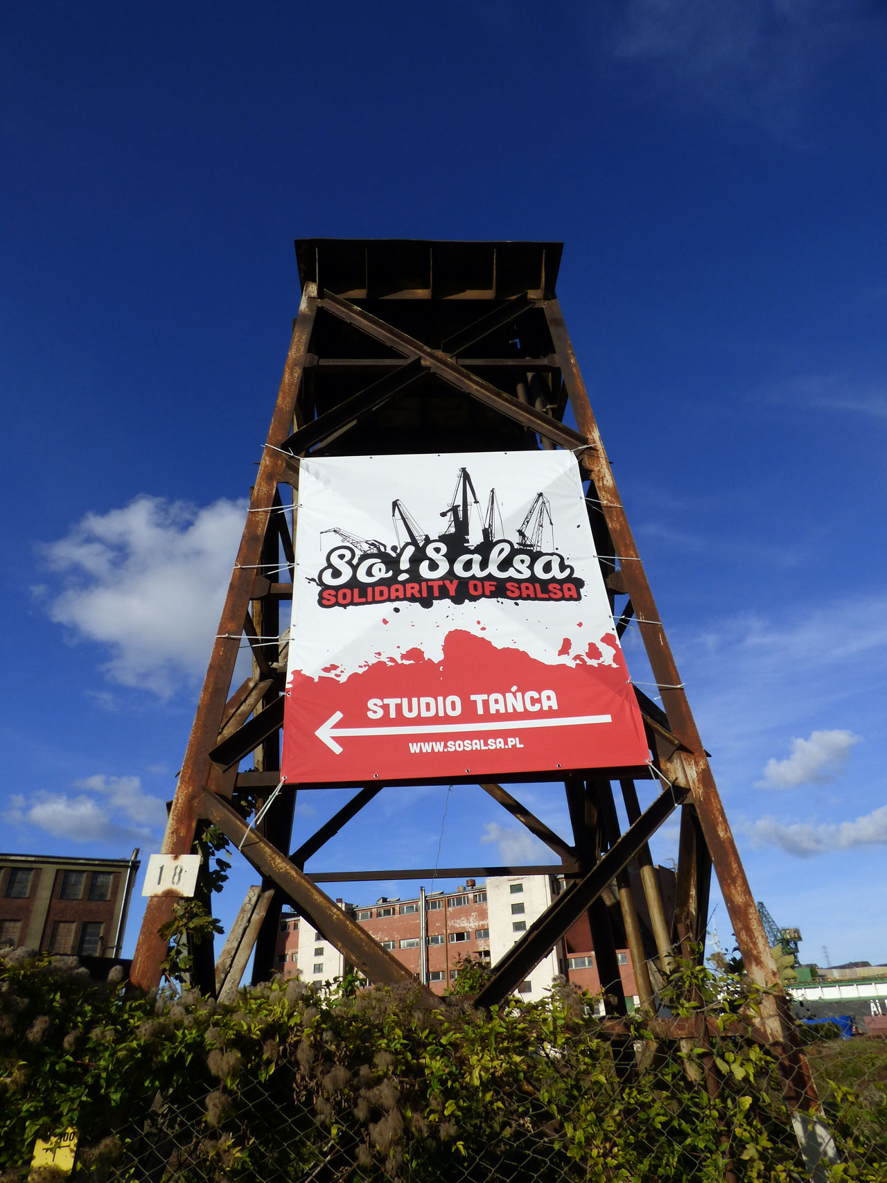 Sign reads 'Solidarity of Salsa'