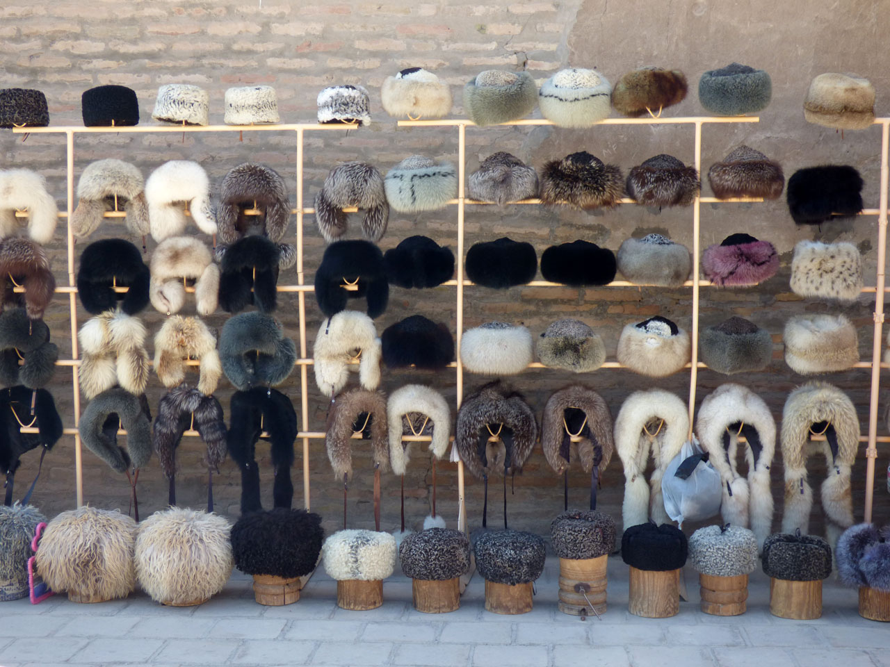 Souvenir hall selling various types of hat, Khiva