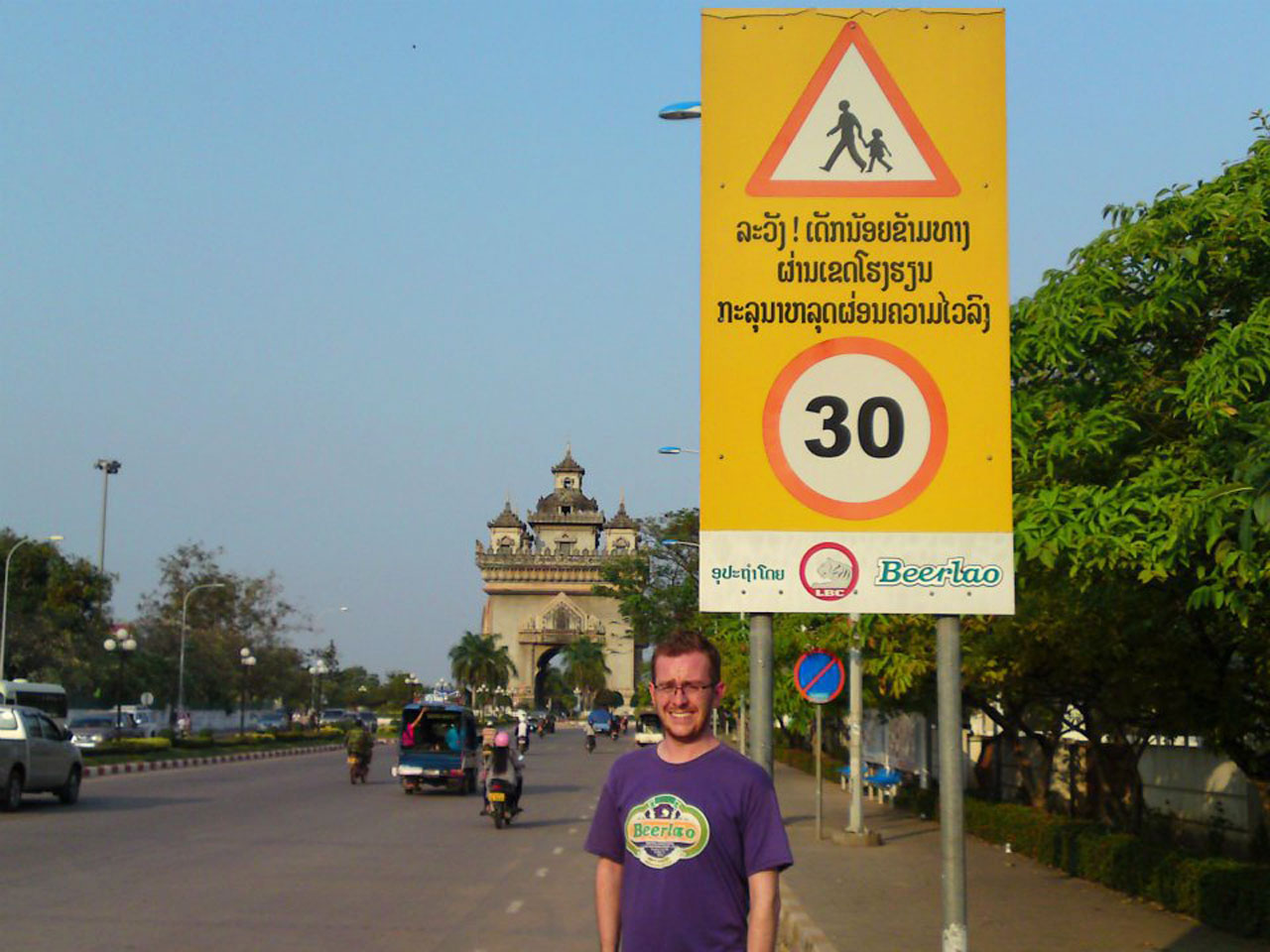 Speed limit sign in Vietiane with advert for Beerlao